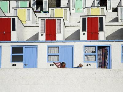 Beach Huts on Tolcarne Beach, Newquay, Cornwall, England-Julian Love-Photographic Print