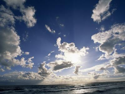 Beach with Gentle Surf under a Sky Filled with Puffy Clouds-Norbert Rosing-Photographic Print