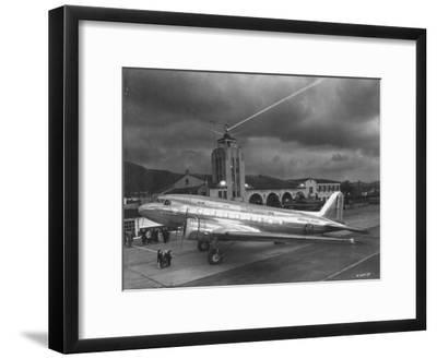 Beacon Shining Forth at Evening from Air Terminal Tower, American Airlines Plane in Foreground--Framed Premium Photographic Print