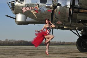 Beautiful 1940's Style Pin-Up Girl Standing in Front of a B-17 Bomber