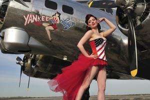 Beautiful 1940's Style Pin-Up Girl Standing under a B-17 Bomber