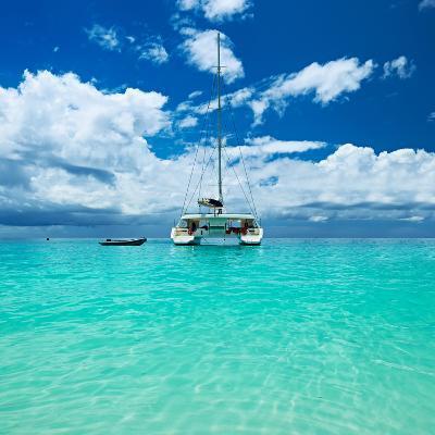 Beautiful Beach with Boat at Seychelles, Praslin, Anse Lazio-haveseen-Photographic Print
