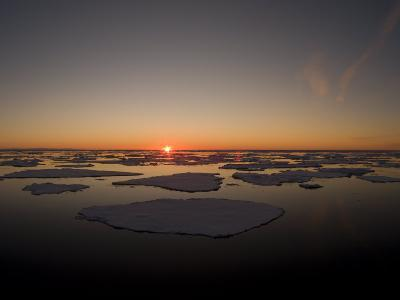 Beautiful Sunset over an Arctic Ice Field, Svalbard, Norway-Norbert Rosing-Photographic Print