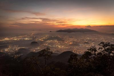 https://imgc.artprintimages.com/img/print/beautiful-view-of-city-and-sunset-clouds-seen-from-bico-do-papagaio-mountain-in-tijuca-forest-rio_u-l-q1gx23u0.jpg?p=0