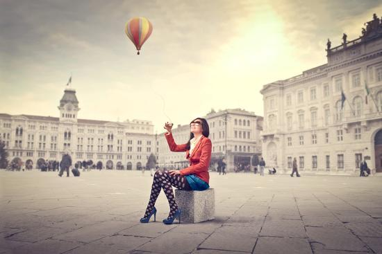Beautiful Woman In Colored Clothes On A Square With Hot-Air Balloon In The Background-olly2-Art Print