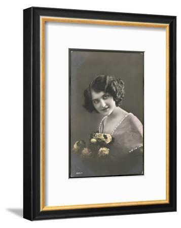 Beautiful Young Lady Holding a Bouquet of Yellow Roses--Framed Photographic Print