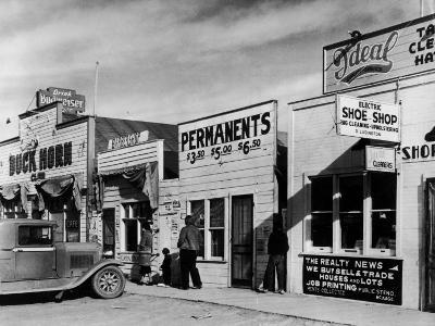 Beauty Parlor Advertising: Permanents: $3.50, $5.00 and $6.50, Shack Town, Fort Peck Dam-Margaret Bourke-White-Photographic Print