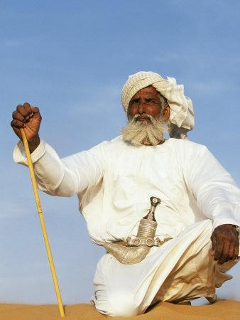 https://imgc.artprintimages.com/img/print/bedouin-man-kneels-on-top-of-a-sand-dune-in-the-desert_u-l-p8xwup0.jpg?p=0