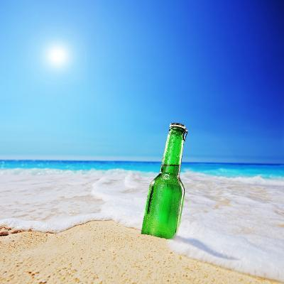 Beer Bottle on a Sandy Beach with Clear Sky and Wave, Shot with a Tilt and Shift Lens-buso23-Photographic Print