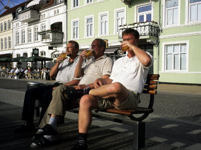 Beer Drinkers Sitting on a Bench, Sonderborg, Denmark-Holger Leue-Photographic Print