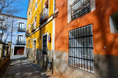 https://imgc.artprintimages.com/img/print/bekah-herndon-goes-for-a-run-in-the-colorful-medieval-old-town-section-of-cuenca-spain_u-l-q19o5wp0.jpg?p=0