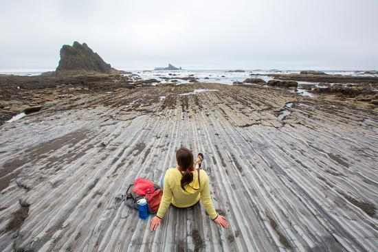 Bekah Herndon Sits On Rock Formations During Hike On Rialto Beach In The Olympic NP In Washington-Ben Herndon-Photographic Print