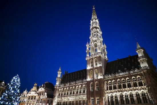 Belgium, Brussels. Grand Place, Holiday lights with a Christmas tree-Walter Bibikow-Premium Photographic Print
