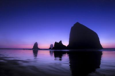 The Sun Sets Behind Haystack Rock at Cannon Beach, Oregon