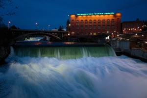 Spokane Falls At High Spring Flow Near Dwtn Spokane, WA Seen From Near Monroe Street Bridge At Dusk by Ben Herndon