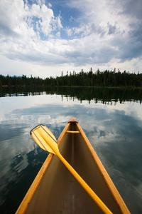 The Front Of A Canoe And Paddle At Upper Priest Lake In North Idaho by Ben Herndon