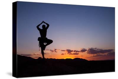 A Climber Practices Yoga Atop a Granite Block as the Sun Sets