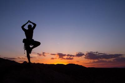 A Climber Practices Yoga Atop a Granite Block as the Sun Sets