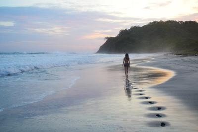 A Girl Walking Down a Tropical Beach in Costa Rica at Sunset by Ben Horton