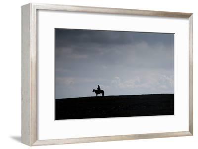 A Man on Horseback on the Mongolian Steppe