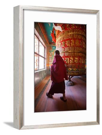A Monk Spins the Worlds Largest Prayer Wheel Near Boudhanath Stupa