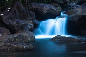 A Waterfall on the Island with Boats' Names Inscribed on the Rocks by Ben Horton