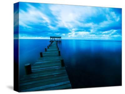 Dusk Light Creates a Surreal Atmosphere around a Dock