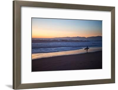 El Porto Beach, Los Angeles, California, USA: A Surfer Exits the Waves at Dusk