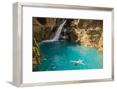 Jacmel, Haiti: A Swimmer Floating in Basin Bleu