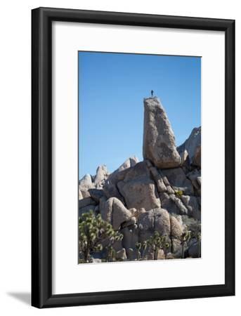 Joshua Tree National Park, California: A Climber on the Headstone Rock Formation