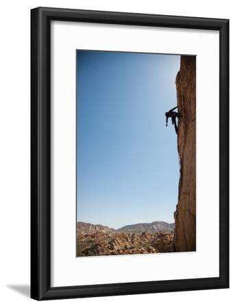 Joshua Tree National Park, California: A Trad Climber Rests While Climbing a Vertical Rock Face