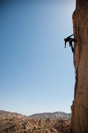 Joshua Tree National Park, California: A Trad Climber Rests While Climbing a Vertical Rock Face