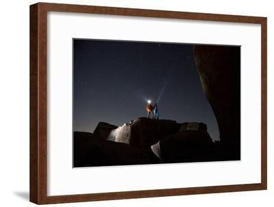 Joshua Tree National Park, California: A Young Couple Stargazing in the Desert on a Moonless Night