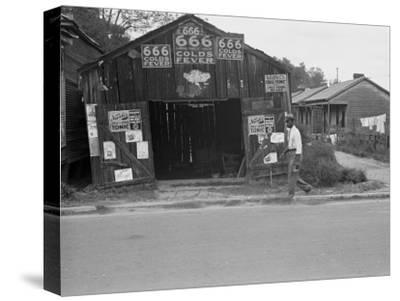 Advertisements for Popular Malaria Cure, Natchez, Mississippi, c.1935