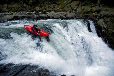 A Young Male Kayaker Drops in to Big Brother on the White Salmon River in Washington