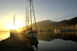 Boats Docked in the Harbor at Fethiye, Sunrise, in Turkey by Bennett Barthelemy