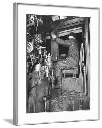 A View of a Santa Fe Railroad Freight Train Conductor Pulling the Whistle Cord