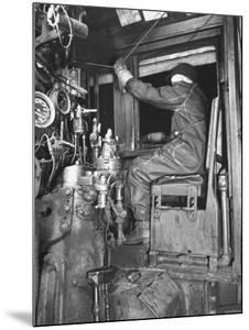 A View of a Santa Fe Railroad Freight Train Conductor Pulling the Whistle Cord by Bernard Hoffman