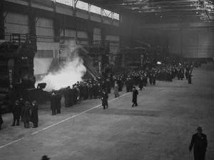 A View of People Touring the Unfinished Irvin Steel Mills by Bernard Hoffman