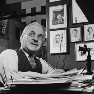 Albert Kahn Sitting at a Desk by Bernard Hoffman
