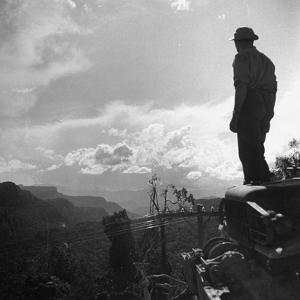 American Soldier Stands on the Hood of a Vehicle on the Ledo Road, Burma, July 1944 by Bernard Hoffman