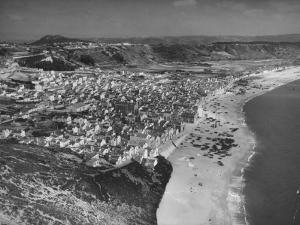 An Aerial View Showing the Fishing Village of Nazare by Bernard Hoffman