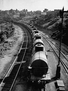 An Oil Tank Train Traveling to it's Destination by Bernard Hoffman