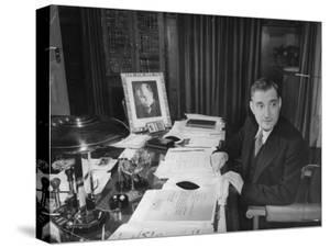 Antonio De Olivera Salazar Sitting at His Desk by Bernard Hoffman