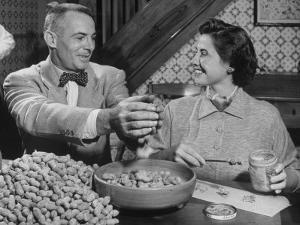 Barbara Angle Helping Her Husband Samuel Angle Prepare Food for the Flying Squirrels by Bernard Hoffman