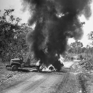 Buring Diesel Truck on the Ledo Road, Burma, July 1944 by Bernard Hoffman
