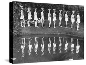 Camera Models at Cypress Gardens, Walking with Blocks on Their Heads For Balance and Posture by Bernard Hoffman