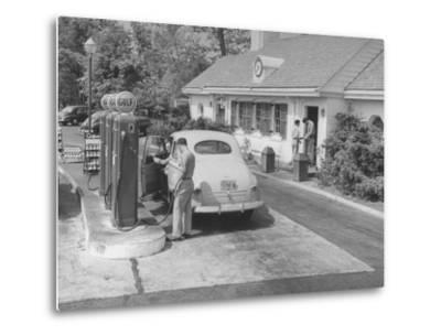 Car Being Filled Up at a Gulf Filling Station Along Merritt Parkway by Bernard Hoffman