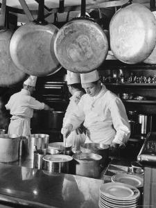 Chefs Cooking in a Restaurant Kitchen at Radio City by Bernard Hoffman
