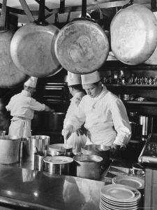 Chefs Cooking in a Restaurant Kitchen at Radio City by Bernard Hoffman